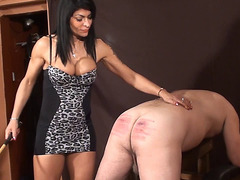 Busty dominatrix in hot caning action